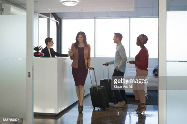 Businesspeople checking in to hotel in the lobby