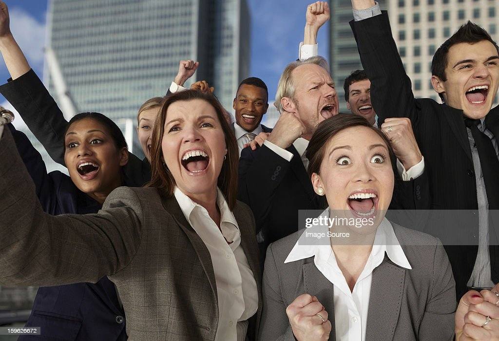 Businesspeople cheering with excitement : Stock Photo