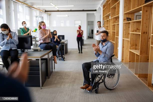 businesspeople clapping hands after a successful meeting - effort stock pictures, royalty-free photos & images
