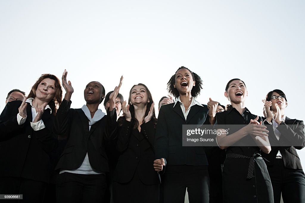 Businesspeople clapping : Stock Photo