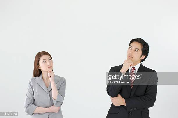 Businesspeople contemplating