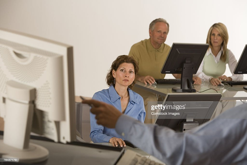 Businesspeople conversing in a meeting : Stockfoto