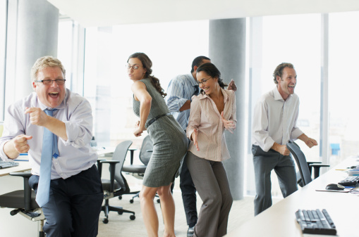 Businesspeople dancing in office - gettyimageskorea