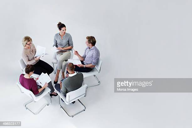 businesspeople discussing in office meeting - five people stock pictures, royalty-free photos & images