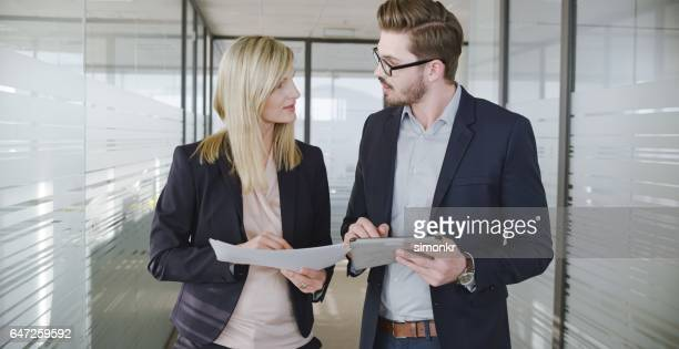 businesspeople discussing in office - side by side stock photos and pictures