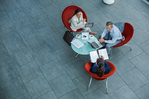 Businesspeople discussing strategy at coffee table - gettyimageskorea