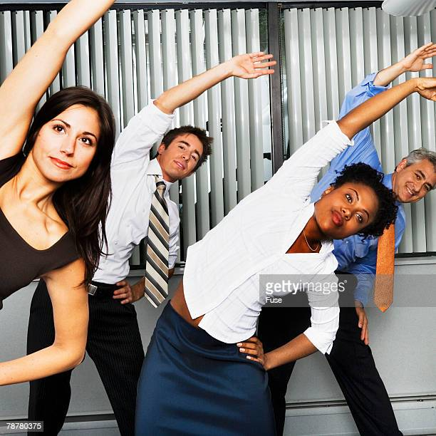 Businesspeople Doing Side Bends