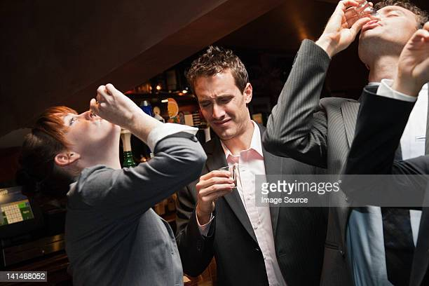 Businesspeople drinking at a bar