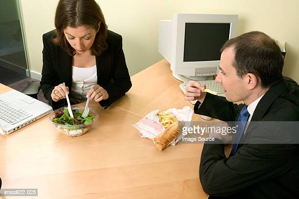 Businesspeople eating lunch