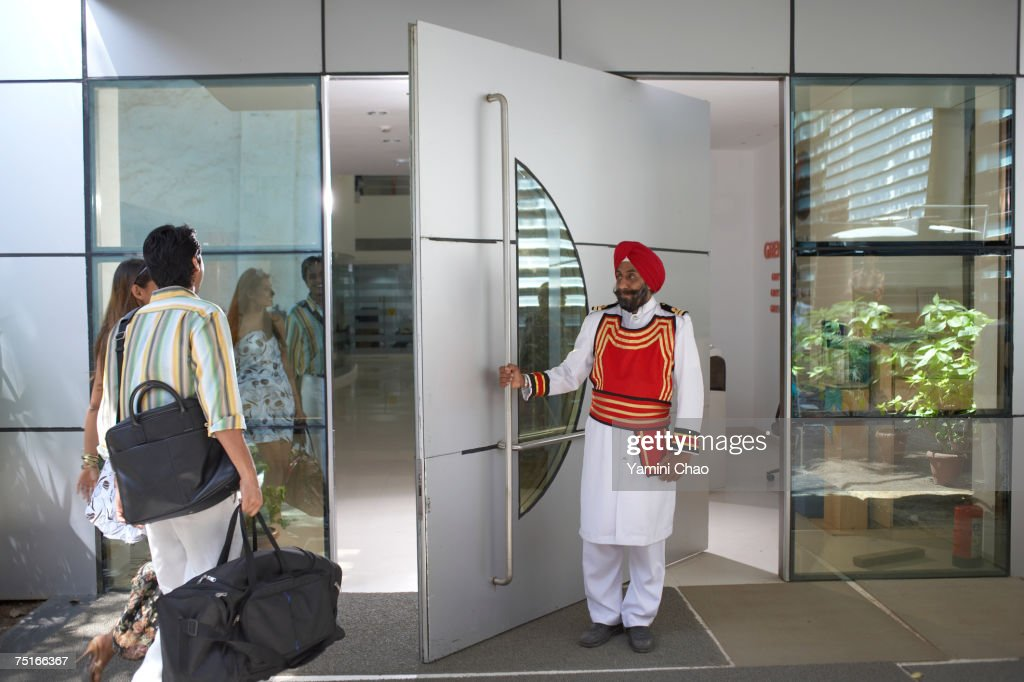 Businesspeople entering in office : Stock Photo