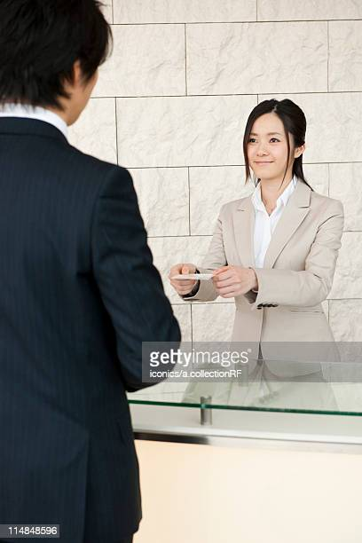 Businesspeople exchanging businesscard, Tokyo Prefecture, Honshu, Japan