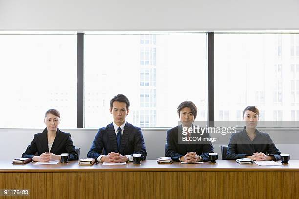 Businesspeople giving interview