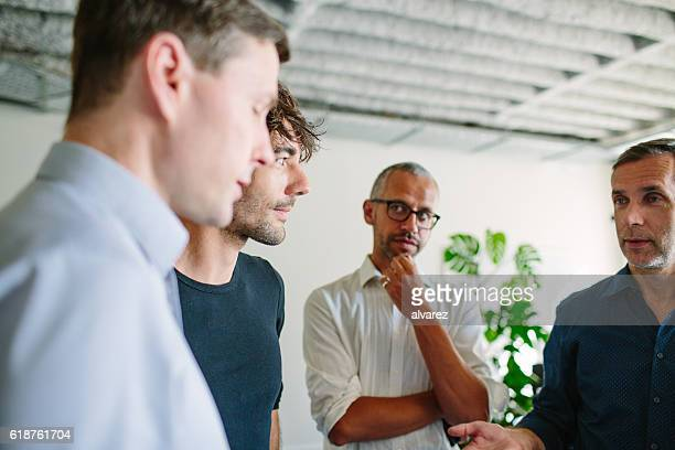 Businesspeople having a standing meeting in office
