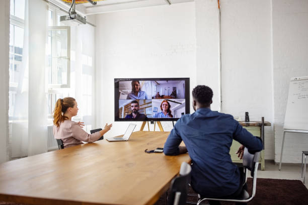 businesspeople having a video conference in office picture id1283895140?k=20&m=1283895140&s=612x612&w=0&h=DT6x0vZDMRI88 Id5 6O1eVQ8VnqJUpt3c eshCWfpI=