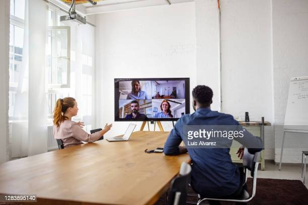 businesspeople having a video conference in office - small group of people stock pictures, royalty-free photos & images