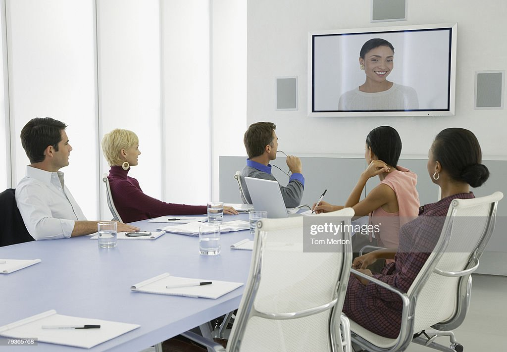Businesspeople having a video conference : Stock Photo