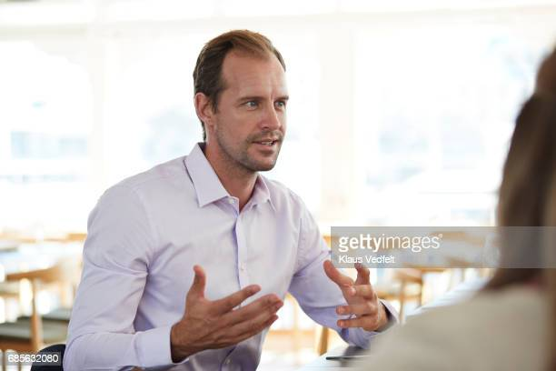 businesspeople having conversations at restaurant - gesturing stock pictures, royalty-free photos & images