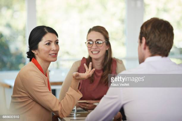Businesspeople having conversations at restaurant