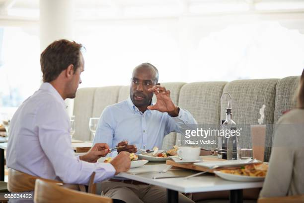 Businesspeople having conversations at restaurant