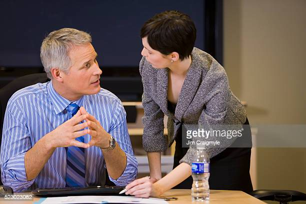 businesspeople having discussion - jim craigmyle stock pictures, royalty-free photos & images