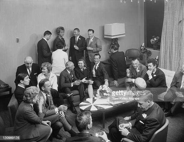 businesspeople having drink in living room - archival stock pictures, royalty-free photos & images