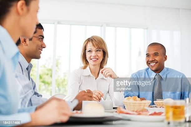 Businesspeople having lunch indoors.