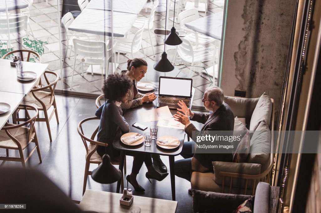 Businesspeople Having Meeting In A Restaurant. : Stock Photo
