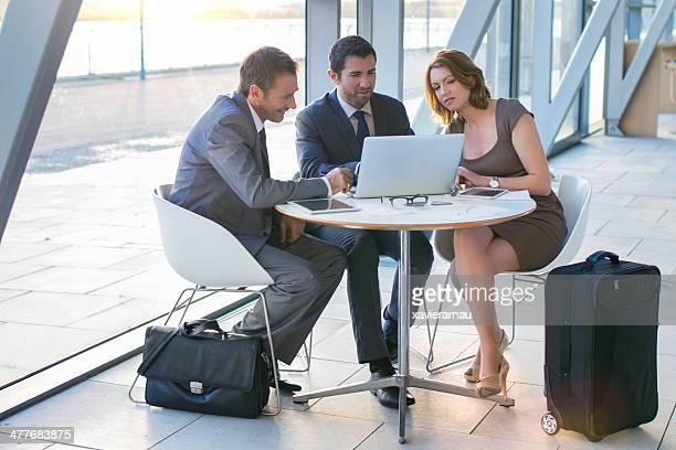 Businesspeople having meeting in airport