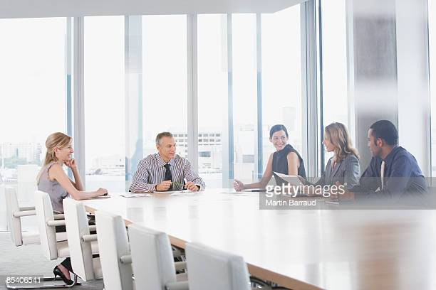 businesspeople having meeting in conference room - conference table stock pictures, royalty-free photos & images