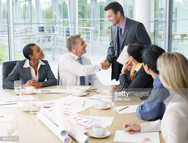 businesspeople having meeting in conference room - finishing stock pictures, royalty-free photos & images
