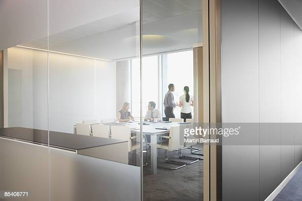 businesspeople having meeting in conference room - glass material stock pictures, royalty-free photos & images