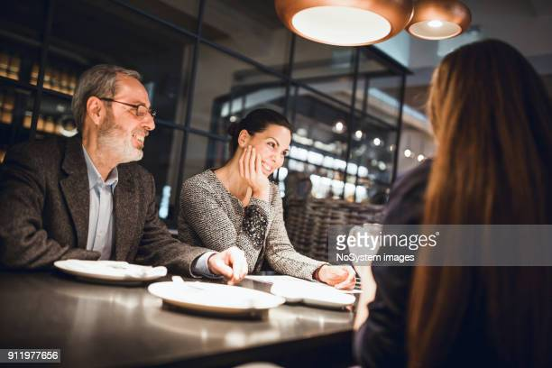 Businesspeople having meeting in in high end restaurant