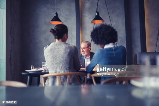 Businesspeople having meeting in in high end restaurant