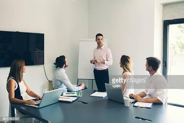 Businesspeople having meeting in office.