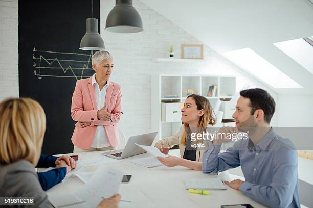 Businesspeople Having Meeting In Their Office.