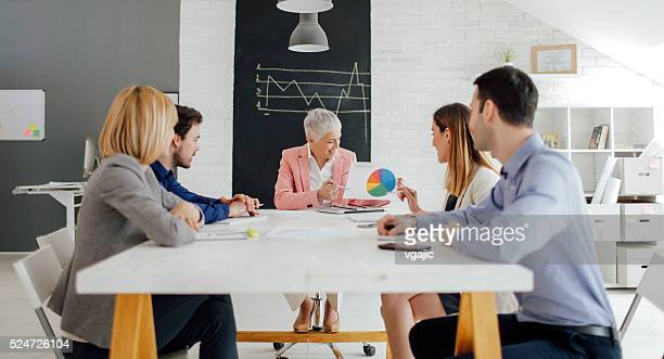 businesspeople having meeting in their office. - wide stock pictures, royalty-free photos & images