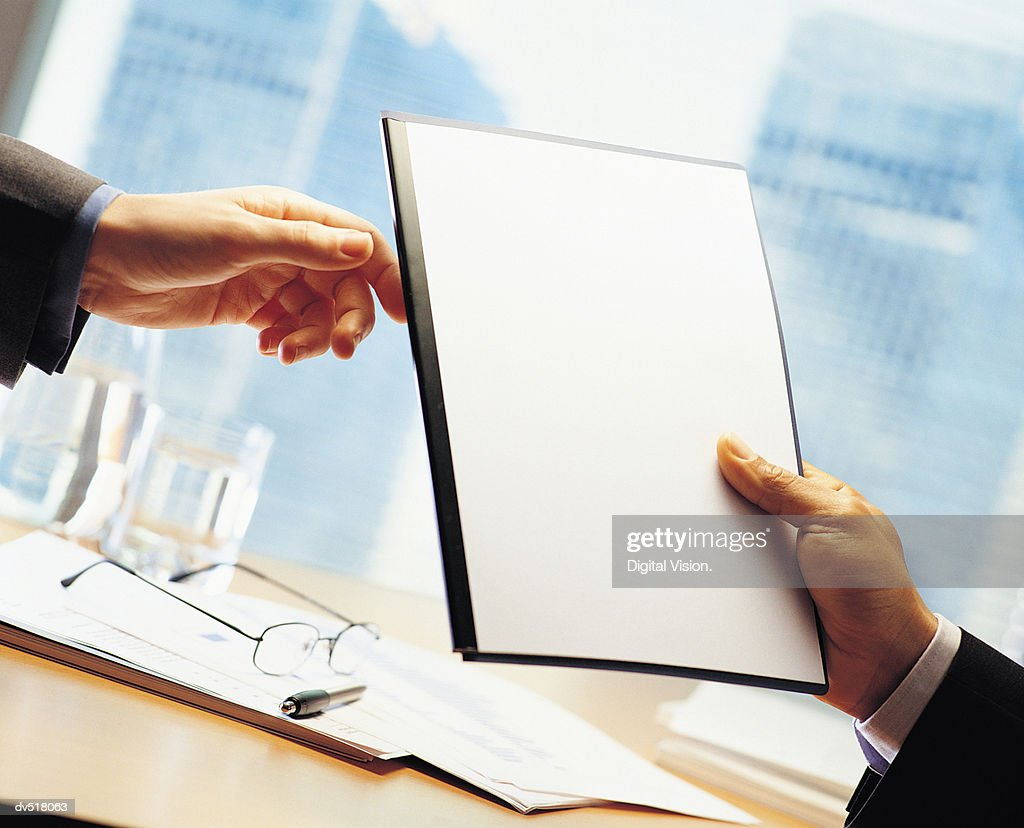 Businesspeople holding blank paper : Stock Photo