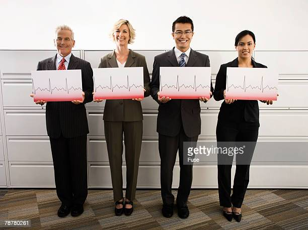 Businesspeople Holding Charts