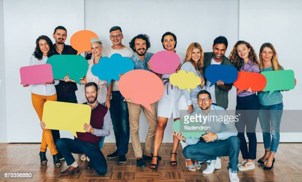 businesspeople holding speech bubbles - promotion employment stock pictures, royalty-free photos & images