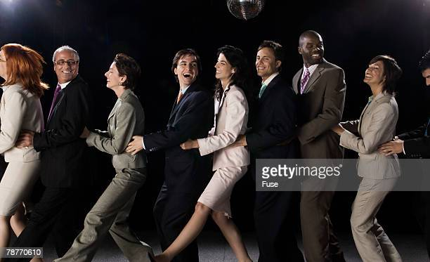 Businesspeople in a Conga Line