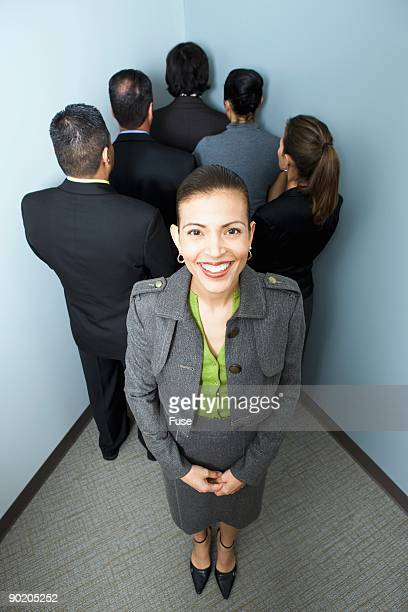 Businesspeople in a corner