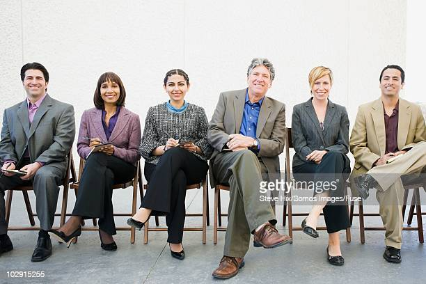 businesspeople in a row - gray blazer stock pictures, royalty-free photos & images