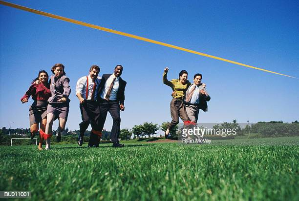 Businesspeople in a Three-legged Race
