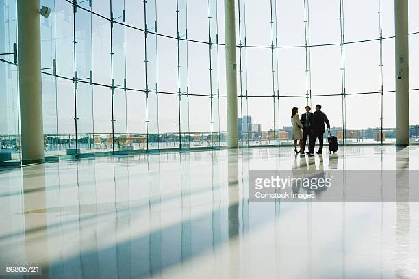 Businesspeople in airport lobby