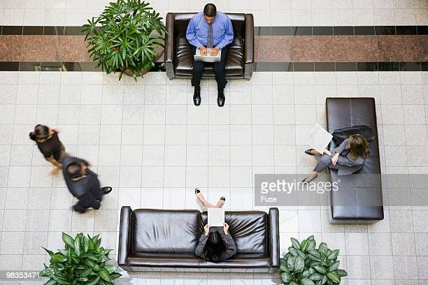 Businesspeople in an office lobby
