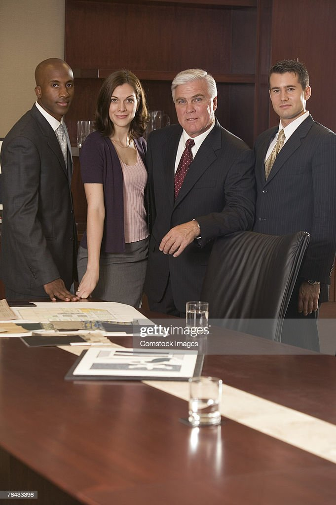 Businesspeople in boardroom : Stockfoto