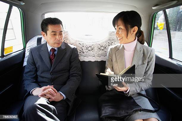 Businesspeople in Car