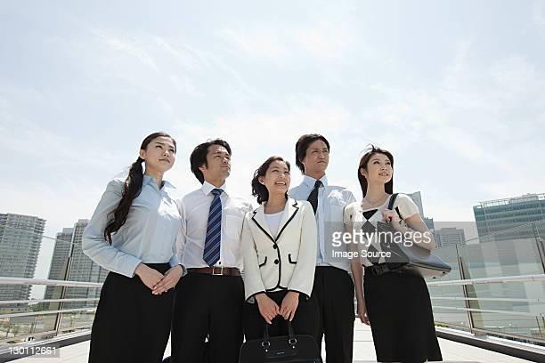 Businesspeople in city scene
