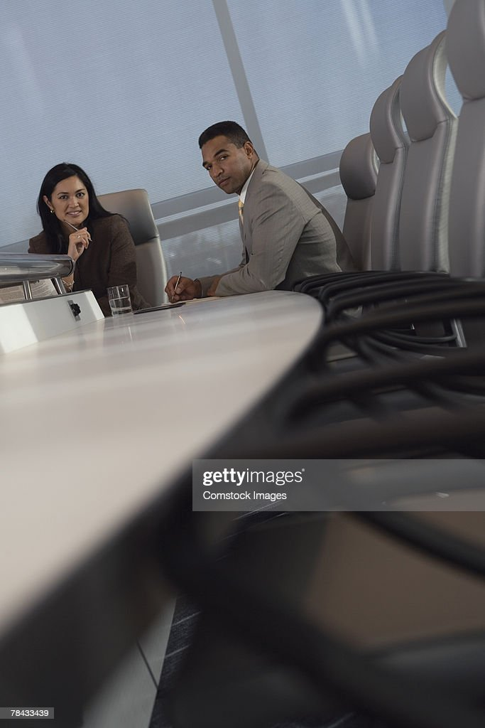 Businesspeople in conference room : Stockfoto