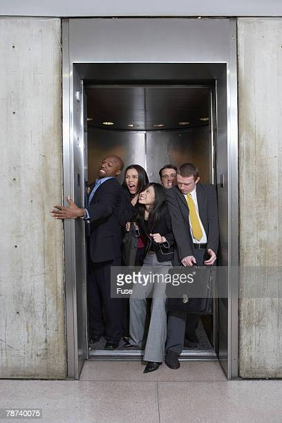 Businesspeople in Crowded Elevator